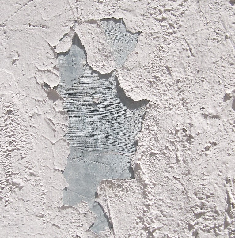 White flaking paint