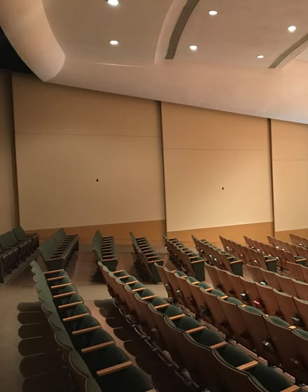 College's auditorium interior painting project photo